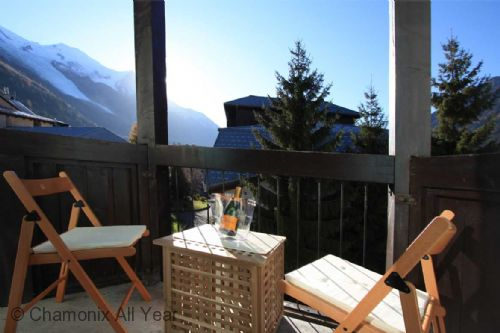 The balcony is a perfect spot to enjoy the mountain views