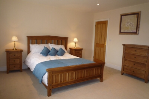 Wilson House, Master Bedroom, Lakes Cottage Holidays