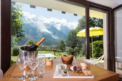 Dining area with stunning mountain views through patio window