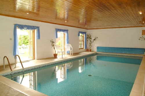 Large house with indoor pool, The Coach House, Haveringland, book with Kett Country Cottages