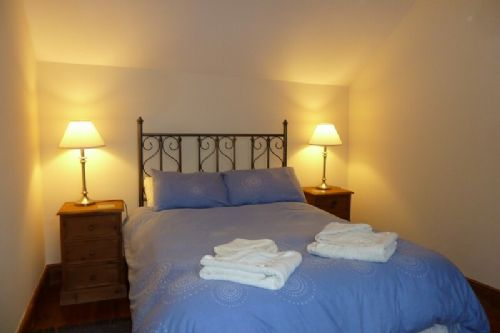 The Byre, bedroom, Lakes Cottage Holidays