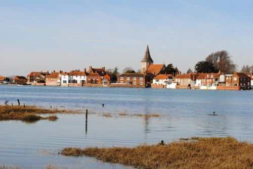 View across Bosham water to the village and Oysters