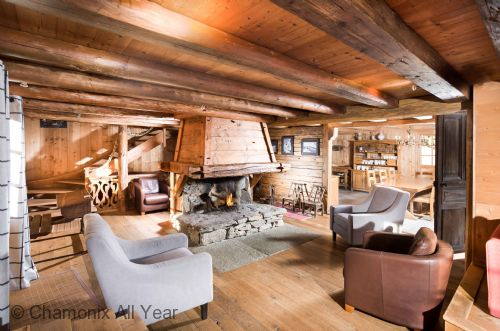 Traditional alpine chalet with open log fire