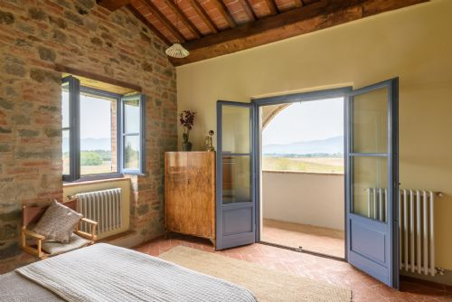Main bedroom, entrance to private terrace and views of Cortona