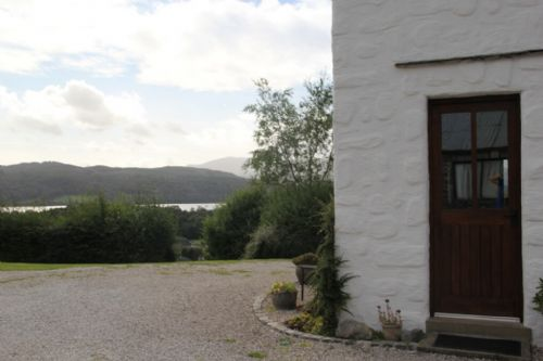 The Stables, front door with view, Lakes Cottage Holidays