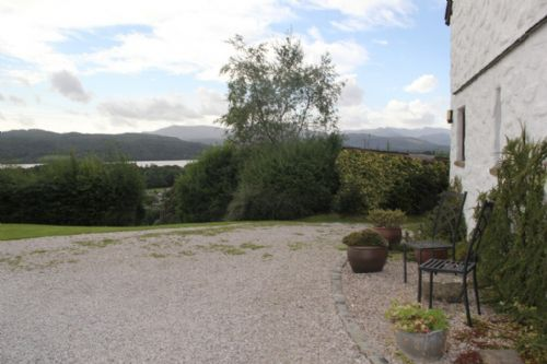The Stables, garden seating area and view, Lakes Cottage Holidays