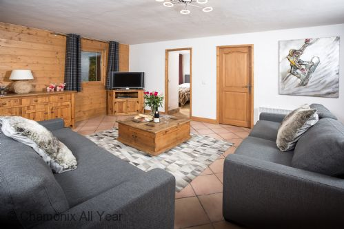 Lounge with 2 large sofas, and balcony overlooking town centre