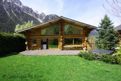 Chalet and garden in summer