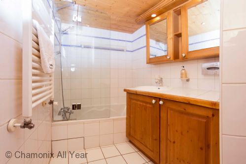 Family bathroom with bath, overhead shower & hand basin