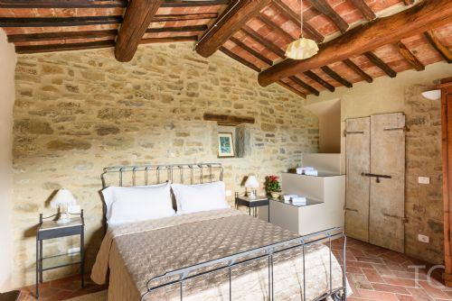 Main bedroom with views of the terrace, valley and pool,