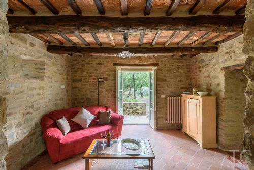 sitting room with french widows to garden and olive grove