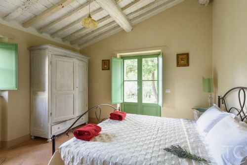 Bright and sunny Bedroom with entrance to garden and olive groves