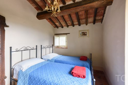 Twin bedded room, with access to small terrace and views
