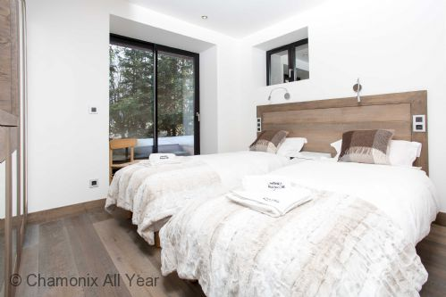 Ground floor bedrooms open onto sunny terrace and hot tub