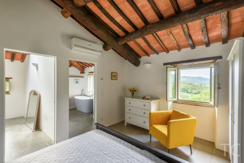 Masterbedroom, bright and airy, with large bathroom and tub with views