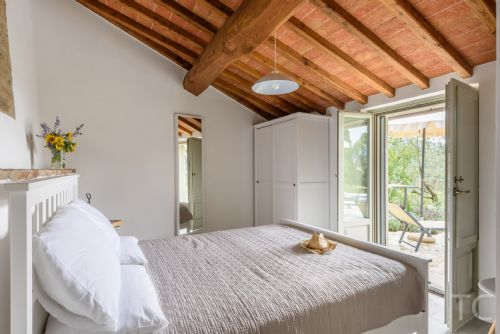 THird bedroom with direct access to terraces and pool