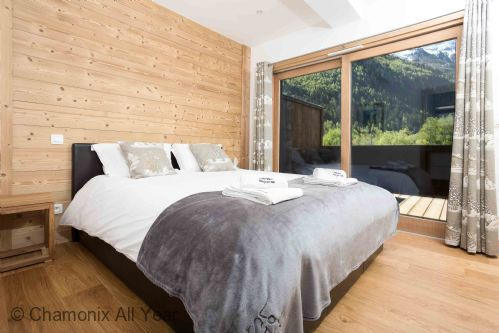 Master bedroom with double bed, opens onto large terrace