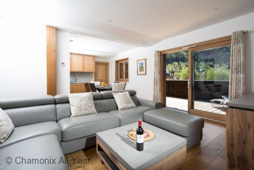 Open plan living area, with large sofa seating up to 8