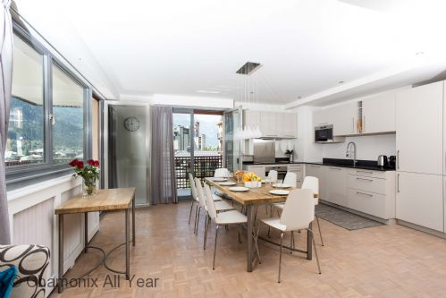 The kitchen is well-equipped, with large comfortable dining table