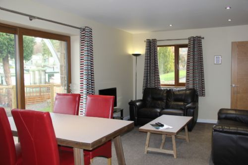 Cherry Cabin, lounge dining, Lakes Cottage Holidays