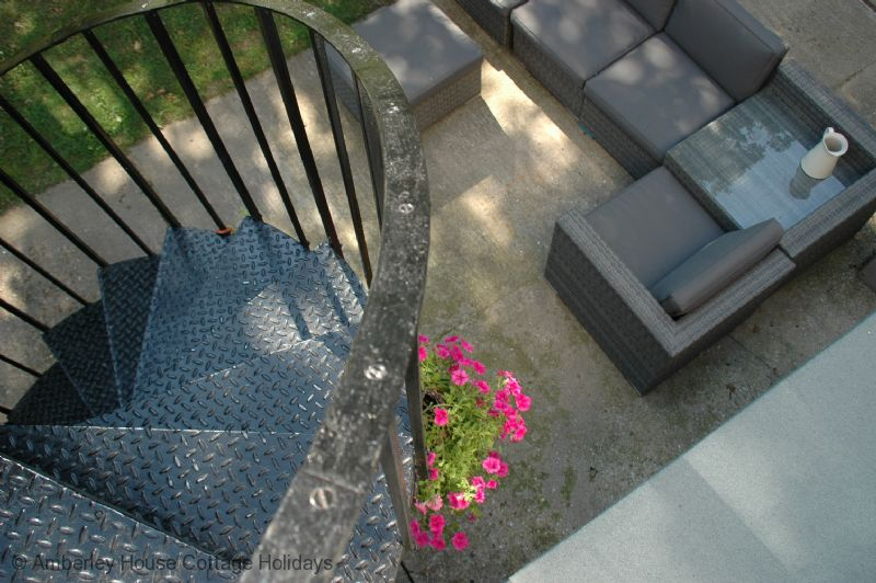 Large Image - A private patio at the foot of the spiral staircase