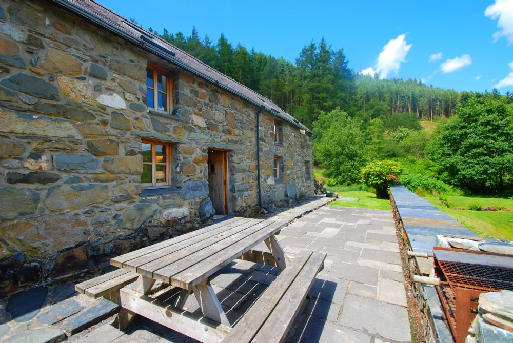 House great escapes wales for Custom cottage fish house prices
