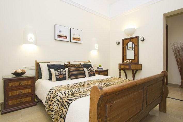 Master bedroom with air conditioning and en-suite bathroom