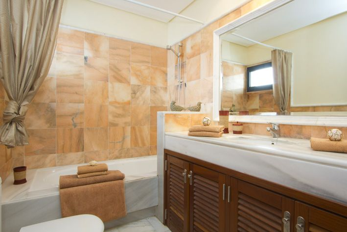 Master bedroom en-suite with bath and shower