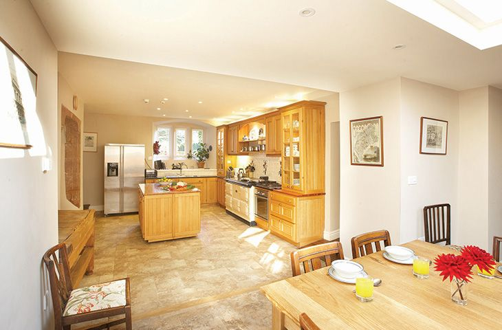Kitchen leading to large orangery dining area