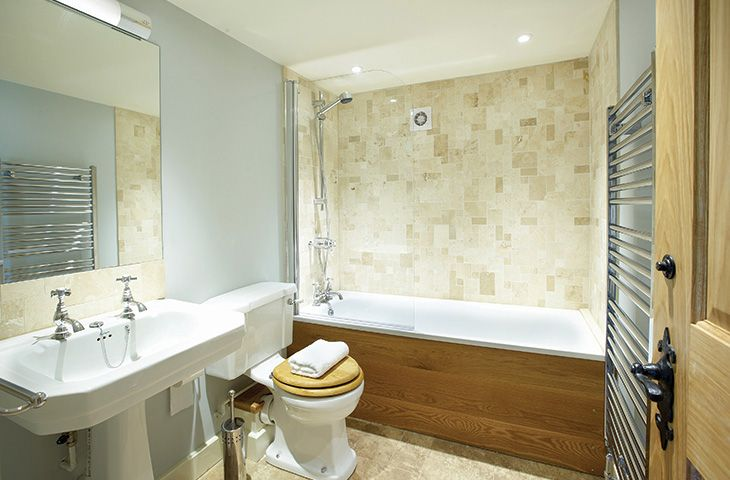Ground floor: En-suite with bath and shower over to double bedroom with 6' zip and link bed