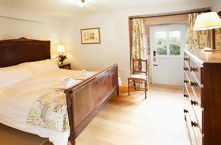 Ground floor: Double bedroom with 5' bed and an en-suite bathroom with a separate power shower