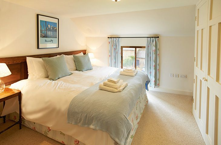 First floor: Twin bedroom with zip and link beds which can be joined together to make a 5' king upon request