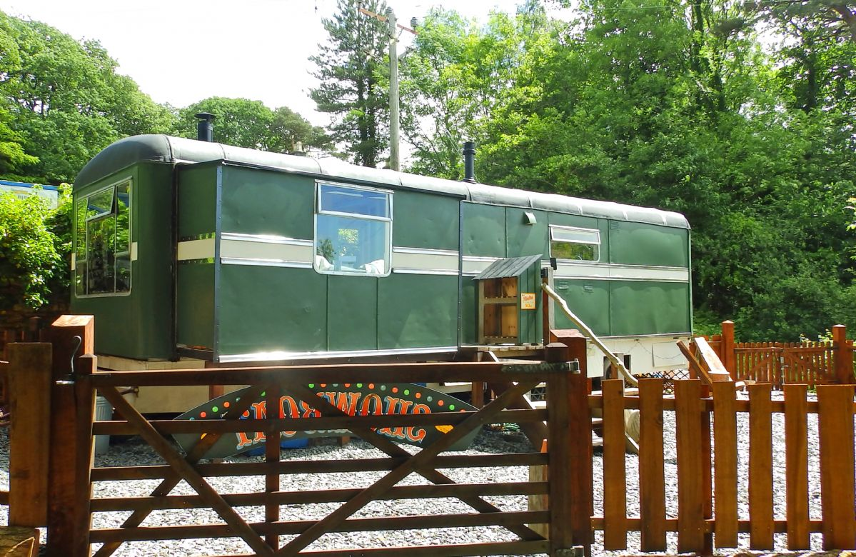 The Showman's Wagon is a renovated 1950s fairground travelling-van overlooking the Mawddach Estuary near Dolgellau in the southern reaches of the Snowdonia National Park