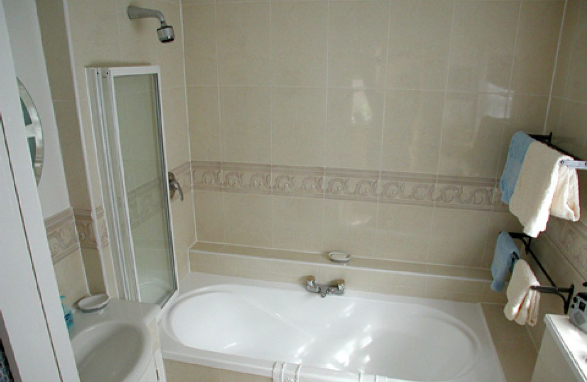 Ground floor: Bathroom with power shower over bath and underfloor heating