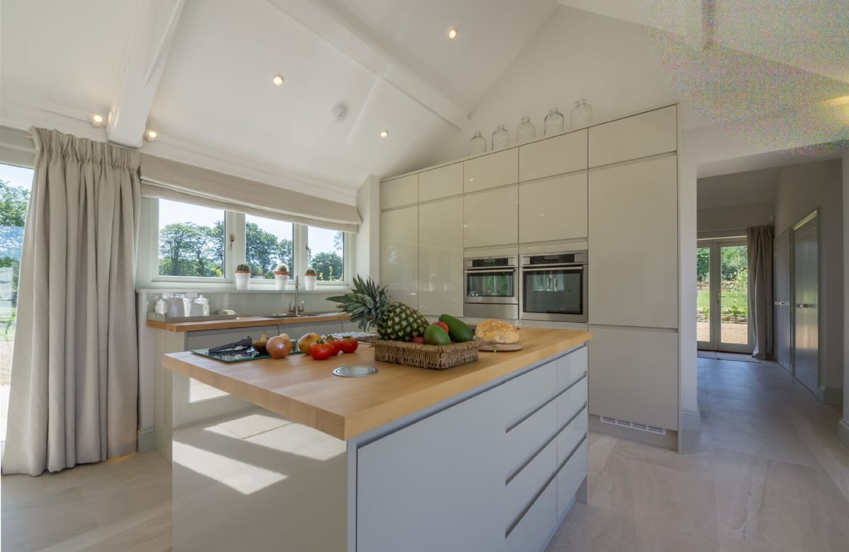 The light and airy kitchen/dining room opens on to the central courtyard