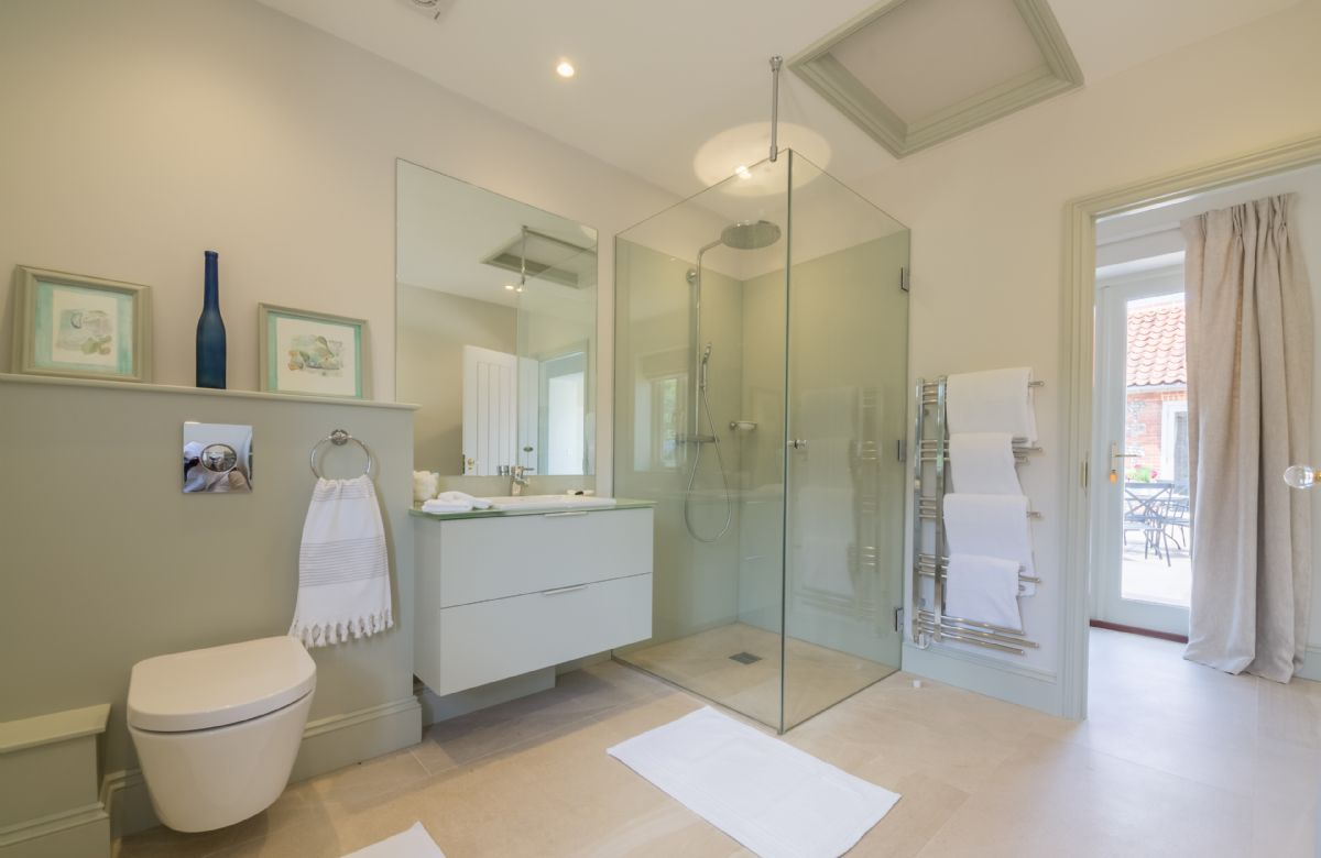 The family bathroom provides a bath and separate