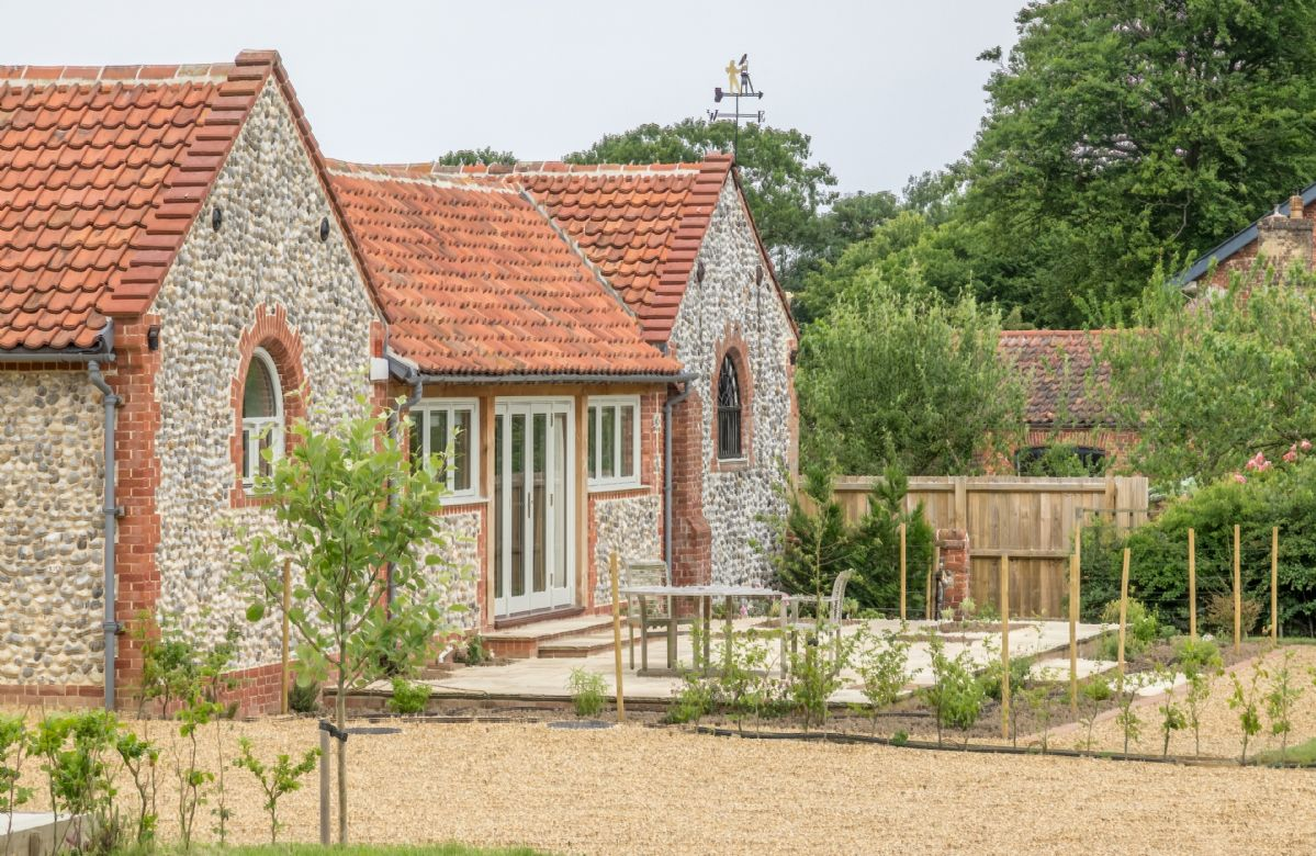 The large private garden offers wonderful open views across park and farmland