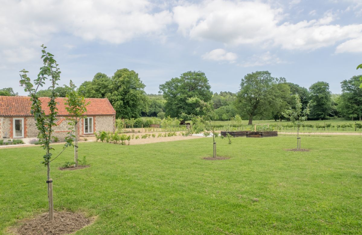 The large garden offers wonderful open views across park and farmland