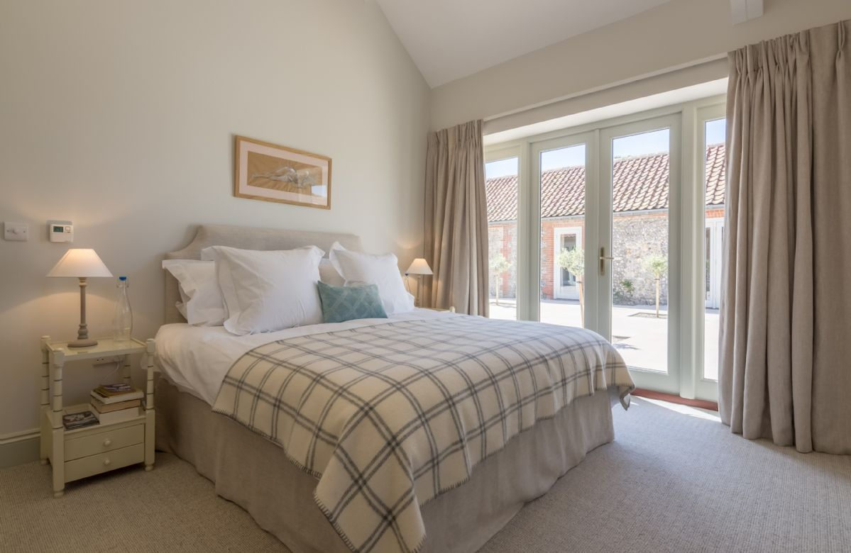 Master bedroom with 6' Super King double and en-suite wet room with large open shower