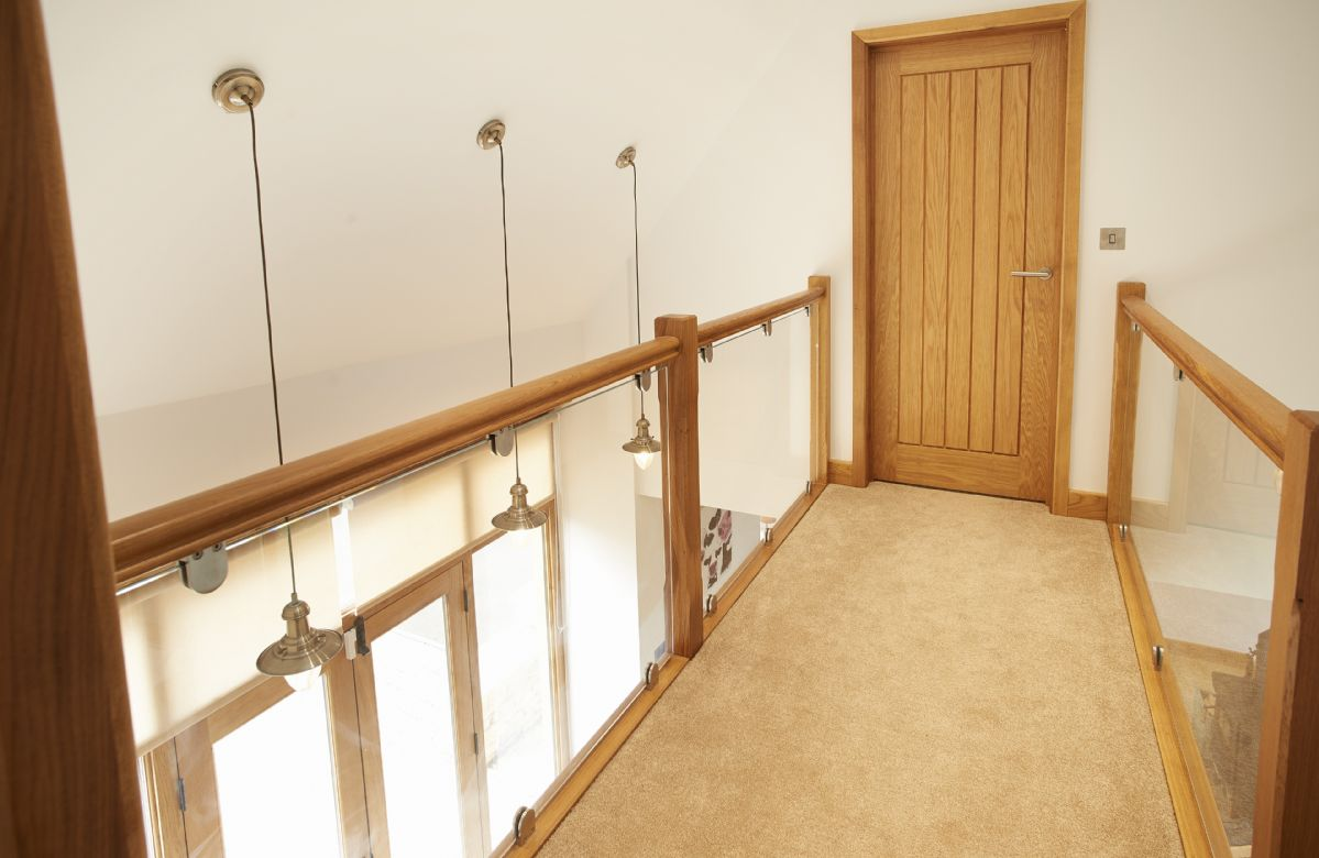 First floor: Galleried landing with glass balustrades and views to main barn ground floor