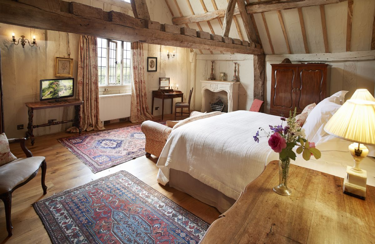 First floor: Spacious 6' Super King double bedroom with views over the Cloister Garden and quince trees