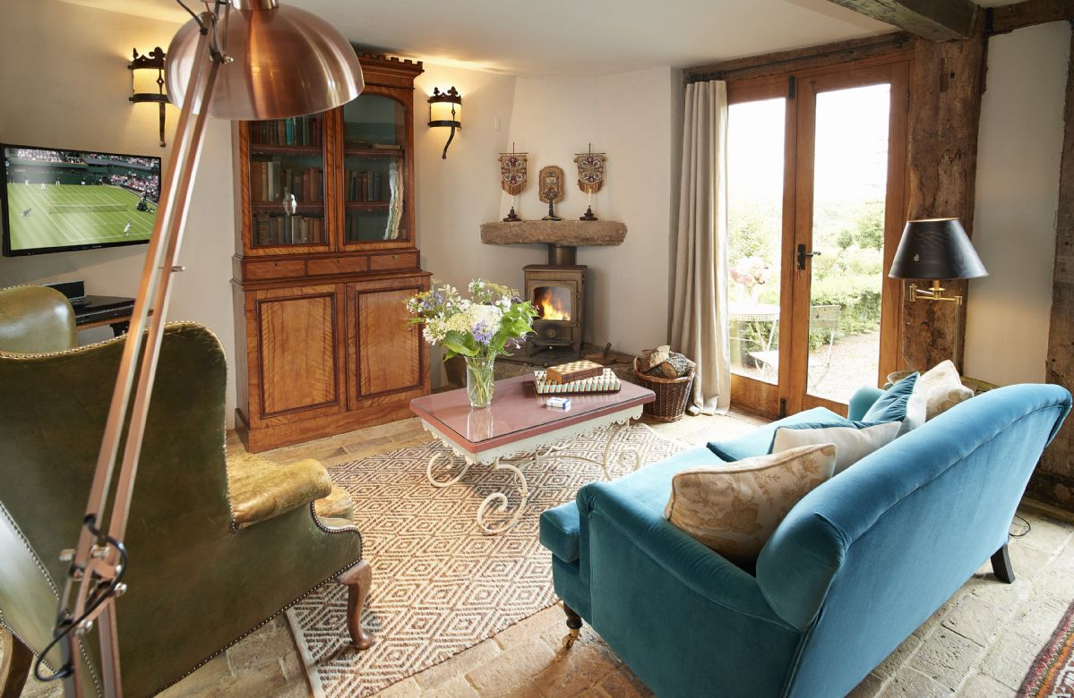 Ground floor: The sitting room has French doors with views out onto the sunken garden, with tables and chairs outside