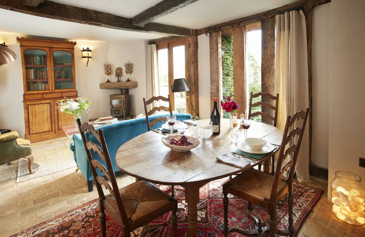 Ground floor: Open plan dining area and sitting room with wood burning stove
