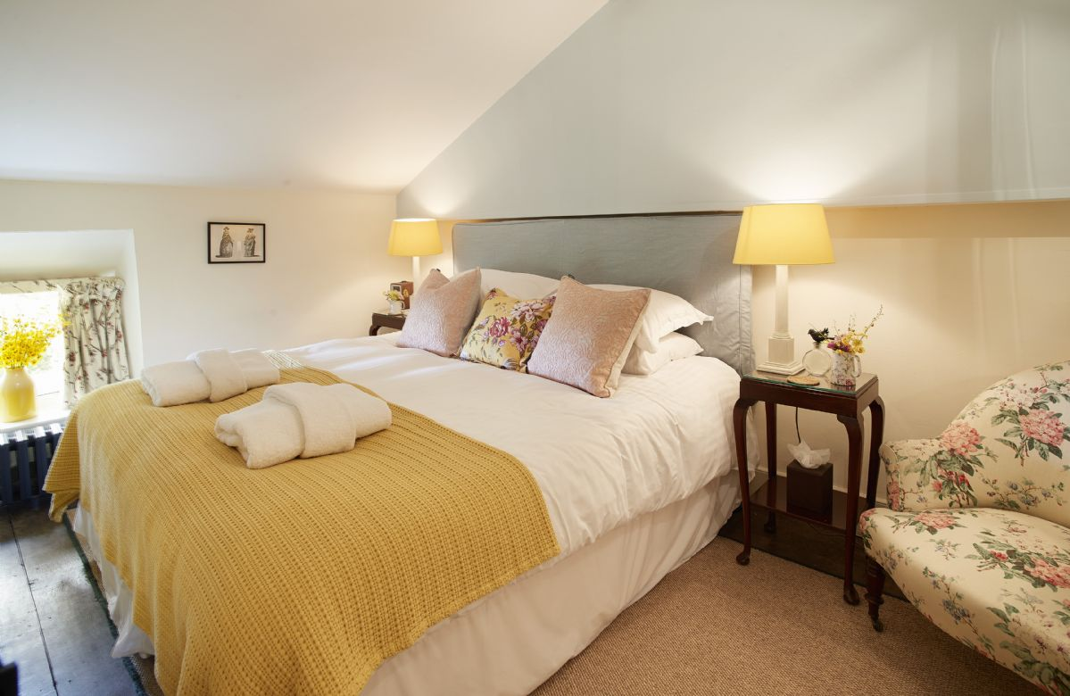 First floor: Double bedroom with 6' zip and link bed which can convert to two single beds upon request