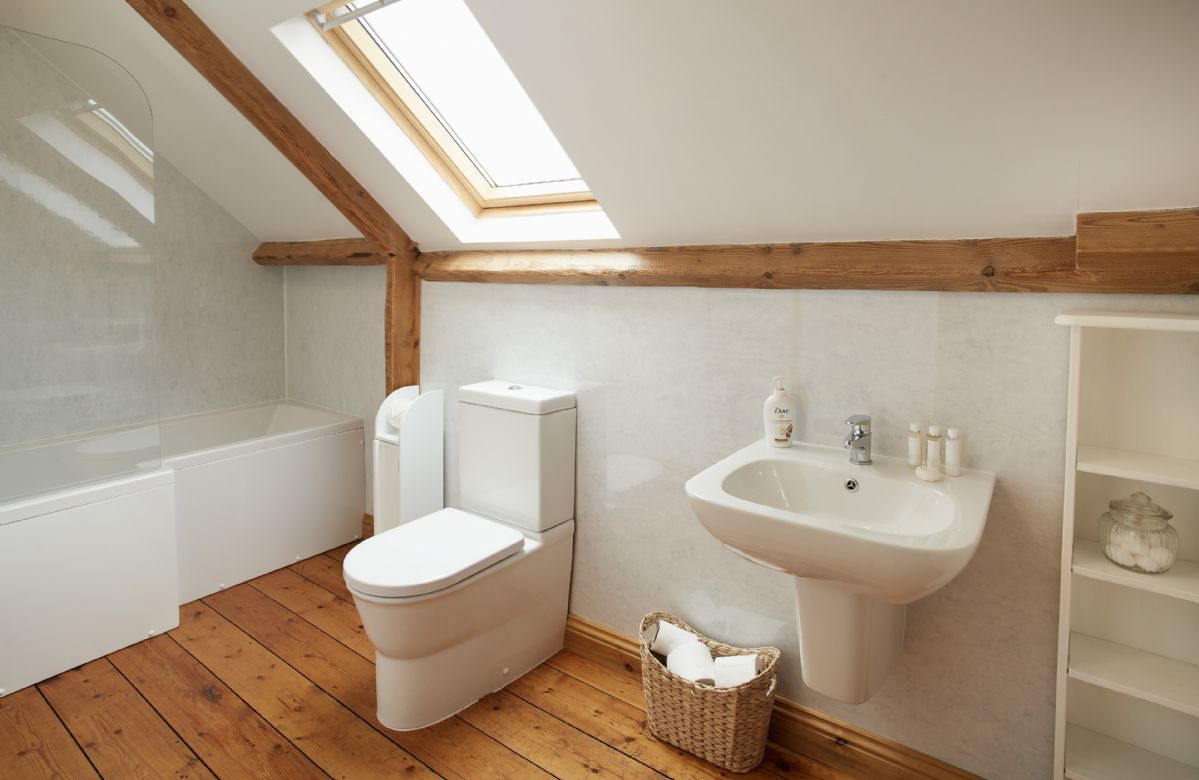 First floor:  Bathroom with bath and overhead shower, wc and basin