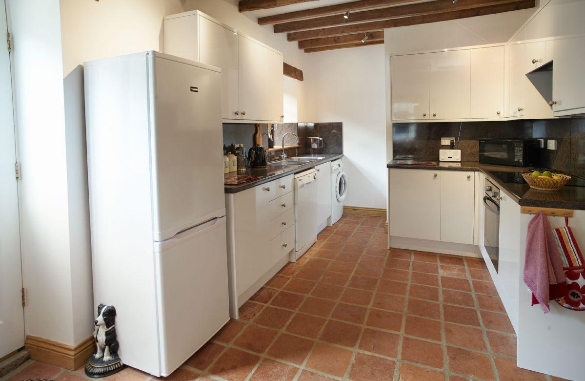 Ground floor:  Kitchen/dining room with original Victorian terracotta tiles