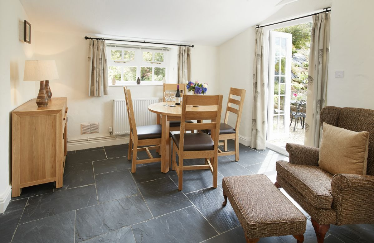 Ground floor: Dining room with french doors leading to the courtyard garden