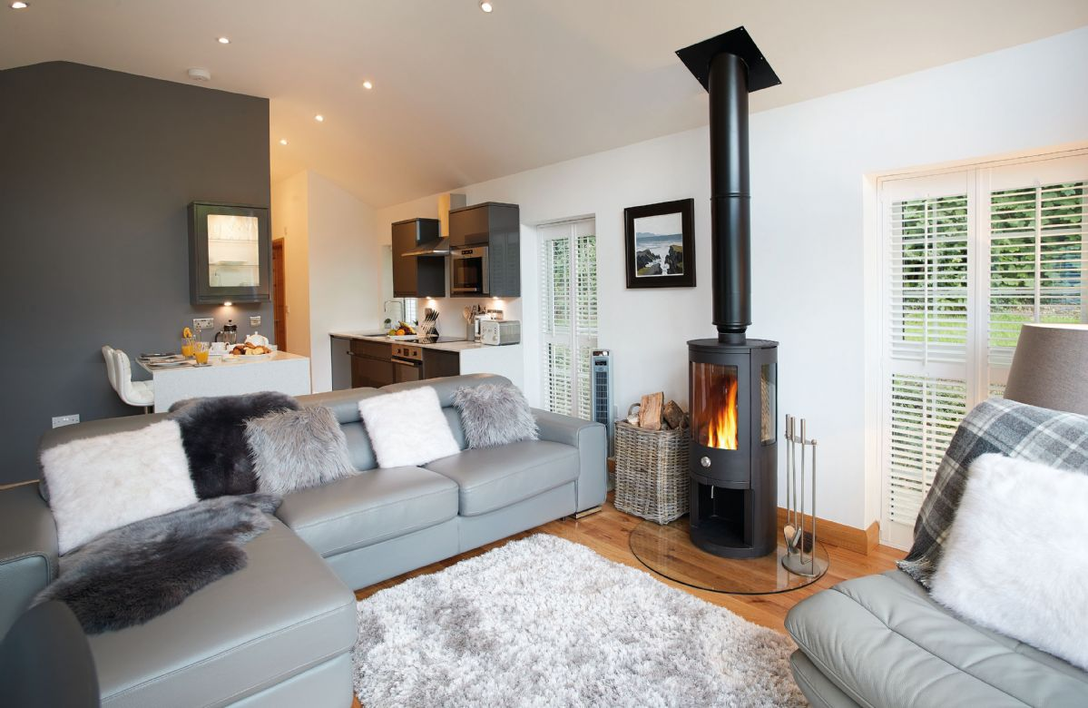 Ground floor: Sitting room with wood burning stove and views to the garden