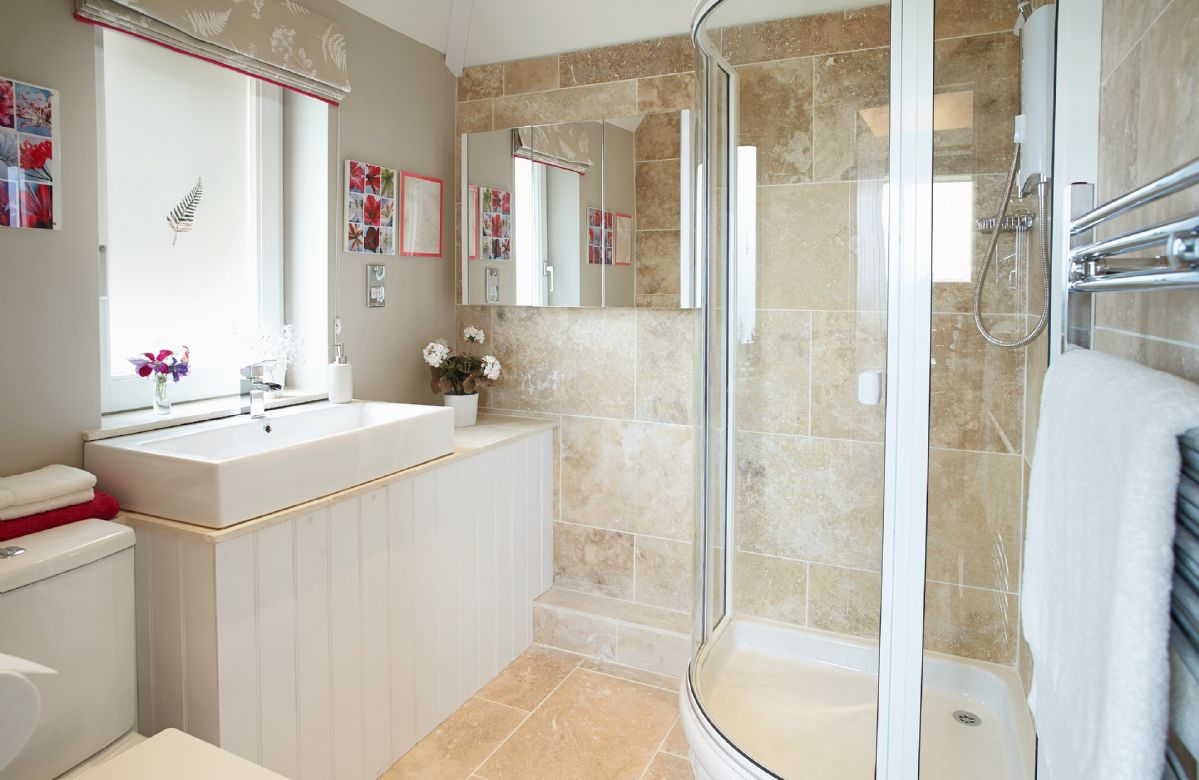 Ground floor:  Travertine-tiled shower room with underfloor heating