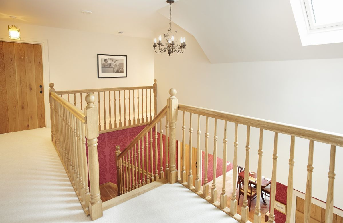 First floor: An oak staircase leads to four double bedrooms and two bathrooms